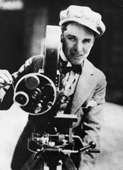Charlie Chaplin (1889 - 1977), English film actor and director operating a movie camera.  Original Publication: People Disc - HW0474   (Photo by Keystone/Getty Images)